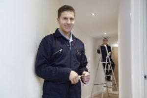 Electricians Installing Office Hall Lighting