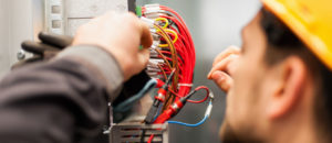 Electrician rewiring electrical services